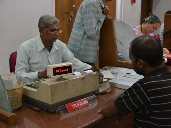 A customer gets his telegram booked at Mumbai's CTO on the day the 163-year-old service draws to a close