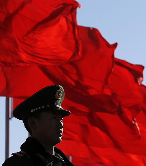 A paramilitary policeman stands guard at Tiananmen Square near the Great Hall of the People in Beijing