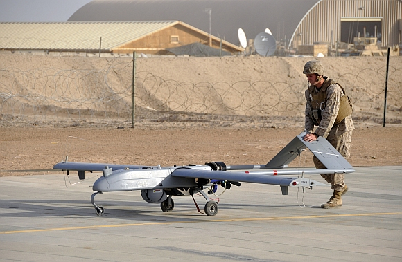 A US marine with a drone following its landing at Camp Leatherneck, Afghanistan