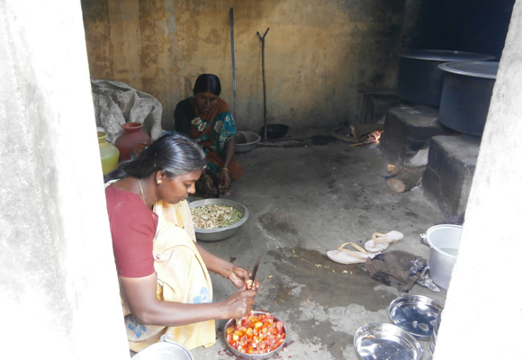 Activity under way in the kitchen at the Sri Ganesar Higher Secondary School in Panickanadarkudieruppu