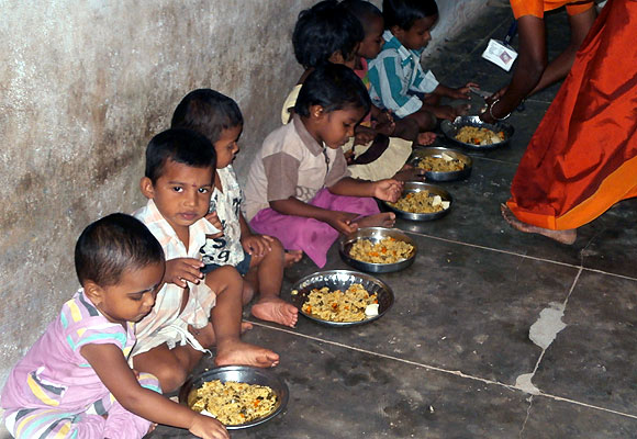 Tiny tots eating a hearty meal at the anganwadi in Nalumavadi revenue village