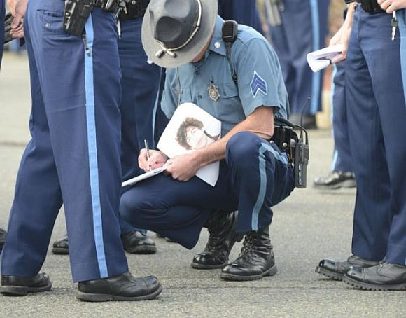Tsarnaev's photo is passed out to troopers during their roll call
