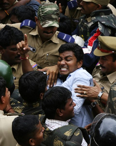 A Telangana supporter clashes with police during a demonstration in Hyderabad