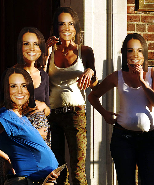Women pretending to be pregnant and wearing masks of Britain's Catherine, Duchess of Cambridge pose outside the Lindo Wing of St Mary's Hospital