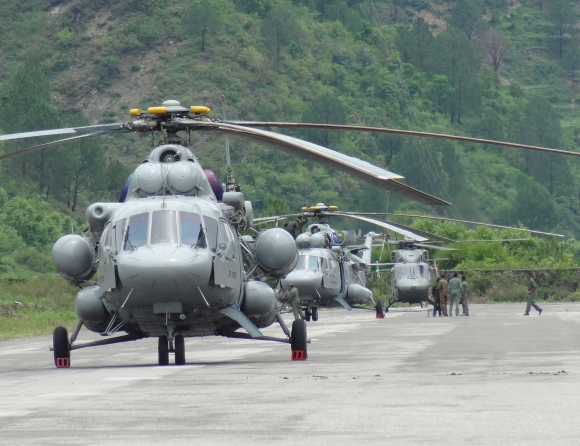 Helicopters parked on the makeshift airfield.