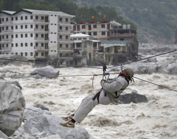 A man is pulled across to safety on a rope over the Alaknanda river in Uttarakhand.