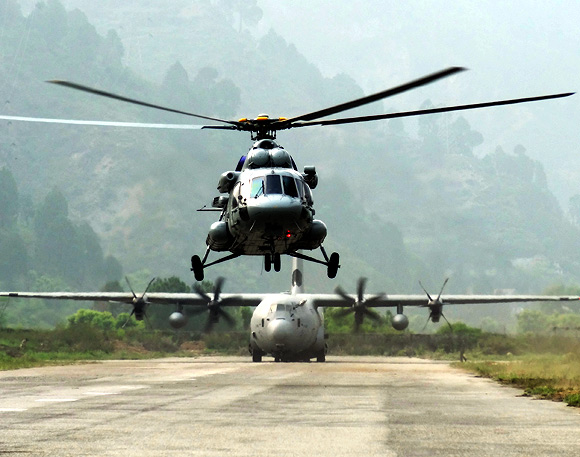 A Mi-17 V5 helicopter and C 130J at Dharasu airfield in Uttarakhand. Men and machine worked through the night to get the runway ready for the giant C 130J to land with fuel supply for day 1 of ops.