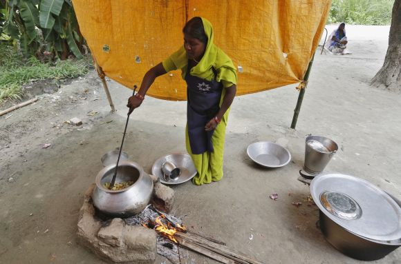A cook prepares food for the free mid-day meal for children at a school in Bihar
