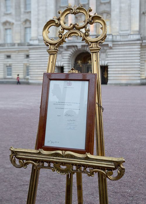 A notice formally announcing the birth of a son to Britain's Prince William and Catherine, Duchess of Cambridge, is placed in the forecourt of Buckingham Palace, in central