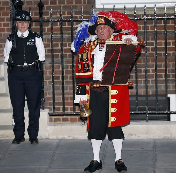 A town crier announces the royal birth outside the Lindo Wing of St Mary's Hospital after Catherine, Duchess of Cambridge gave birth to a baby boy in central London