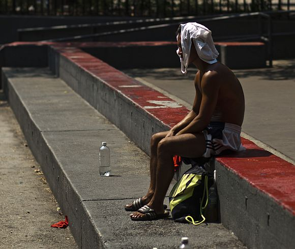 A man rests during a heat wave in Manhattan