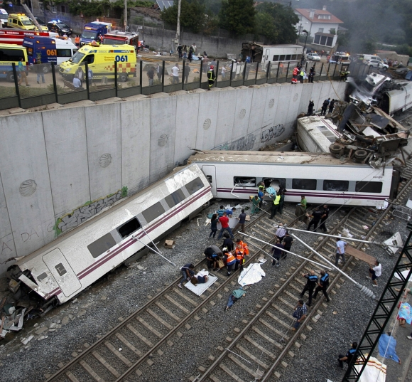 Rescue workers pull victims from a train crash near Santiago de Compostela, northwestern Spain