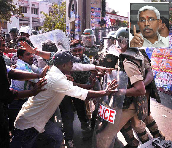 Osamania University students clash with the police during an agitation for Telangana in Hyderabad (Inset) Prof Kodandaram