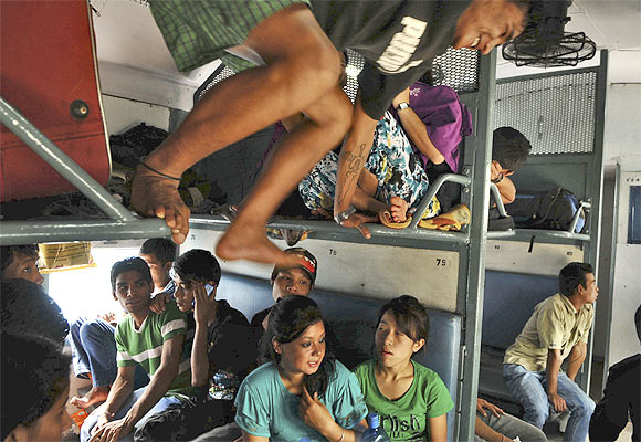People from the North-East on a train on their way back to their homes at a railway station in Bangalore, August 17, 2012.