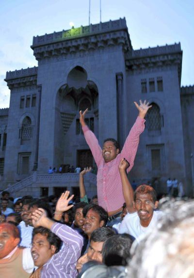 Osmania University students celebrate the declaration of a separate state of Telangana at the university campus in Hyderabad