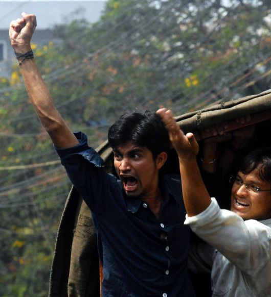 Police detain pro-Telangana activists in Hyderabad during an agitation for separate state