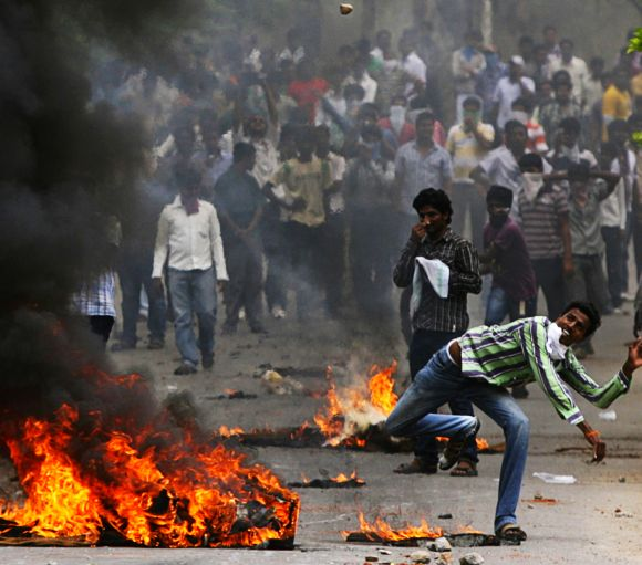 Pro-Telangana students clash with police personnel during an agitation in Hyderabad