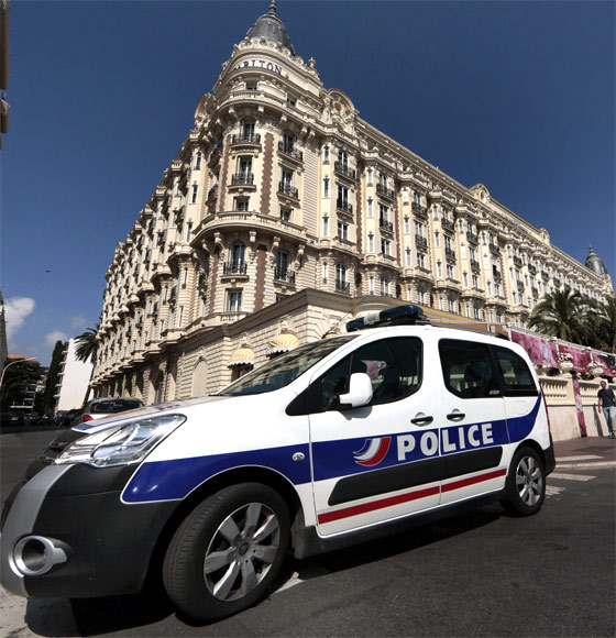 A police car parked outside the Carlton hotel in Cannes, from where gems worth Rs 8.2 billion were stolen in an audacious heist