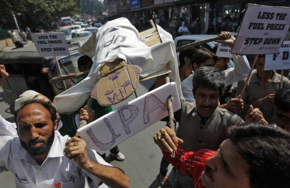 BJP workers carry a mock funeral pyre symbolising the UPA government