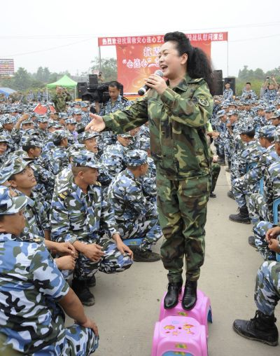 Peng Liyuan sings during a performance as she visits soldiers after the 2008 Wenchuan earthquake in Deyang, Sichuan province