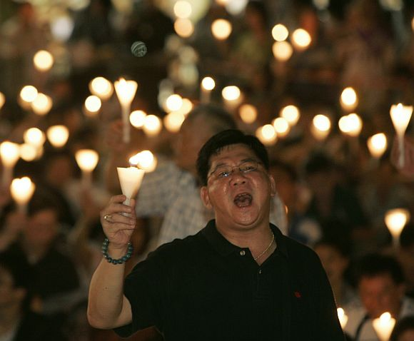 Protesters sing as they take part in a candlelight vigil at Hong Kong's Victoria Park