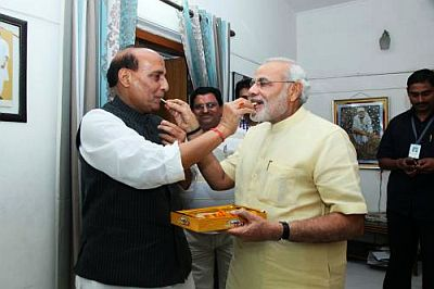 BJP president Rajnath Singh congratulates Gujarat CM Narendra Modi following bypoll victory