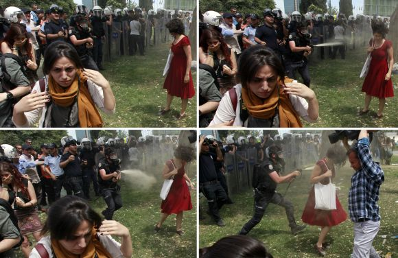 A combination photo of a Turkish riot policeman using tear gas against a woman as people protest against the destruction of trees in a park brought about by a pedestrian project, in Taksim Square in central Istanbul