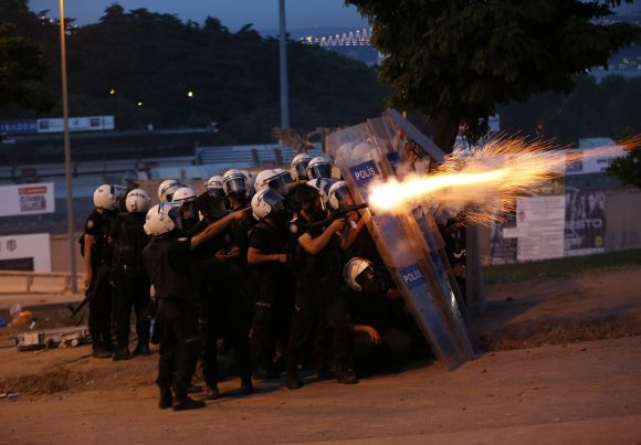 Riot police use tear gas to disperse the crowd during an anti-government protest in Istanbul