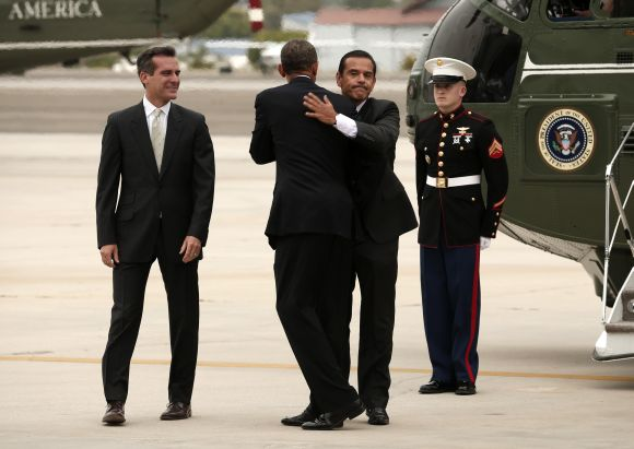 US President Barack Obama hugs outgoing Los Angeles Mayor Antonio Villaraigosa upon his arrival in Santa Monica to attend a fundraiser