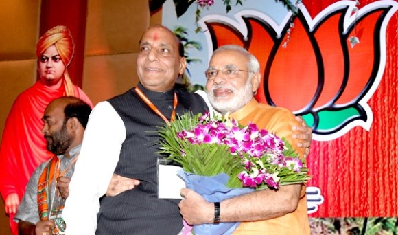 BJP chief Rajnath Singh hugs Gujarat Chief Minister Narendra Modi at the Goa conclave on Sunday