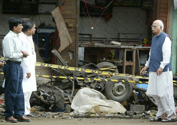 Former Home Minister L K Advani inspecting the site of a bomb blast in Mumbai in 2003