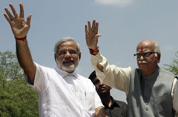 Advani with Gujarat Chief Minister Narendra Modi during a campaign rally in Gandhinagar.