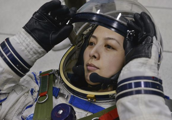 Chinese astronaut Wang Yaping adjusts her helmet during a training at Beijing Aerospace City