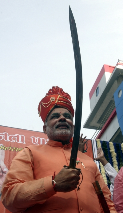 Modi poses with a sword in Ahmedabad
