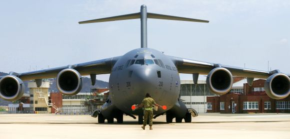 A Boeing C-17 Globemaster III aircraft arrives at the Fairbairn Air Force Base near Canberra, Australia