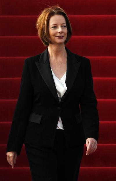 Australian PM Julia Gillard arrives at Vientiane airport in Laos November 4, 2012