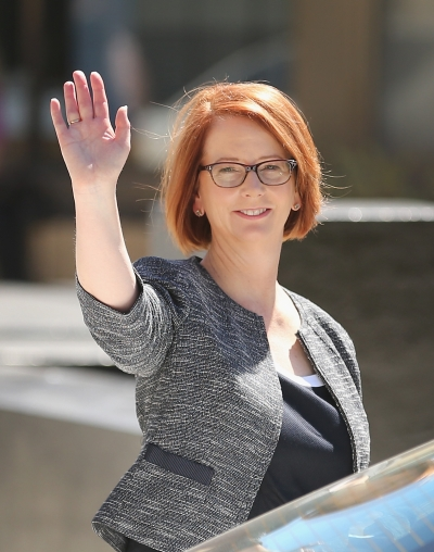 Gillard waves as she leaves Melbourne