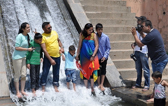 Tourists pose for pictures at Nishant Gardens