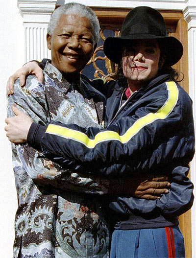 Nelson Mandela and pop star Michael Jackson hug each other at the president's official home in Capetown in this July 20, 1996 file photo