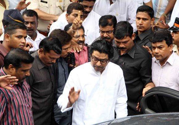 MNS chief Raj Thackeray waves to supporters as he steps out of a court in Bandra on Wednesday