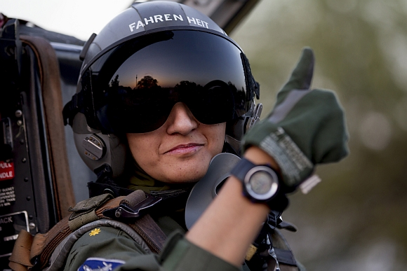Ayesha gives the thumb-up sign from the cockpit of a Chinese-made F-7PG fighter jet at Mushaf base in Sargodha, north Pakistan