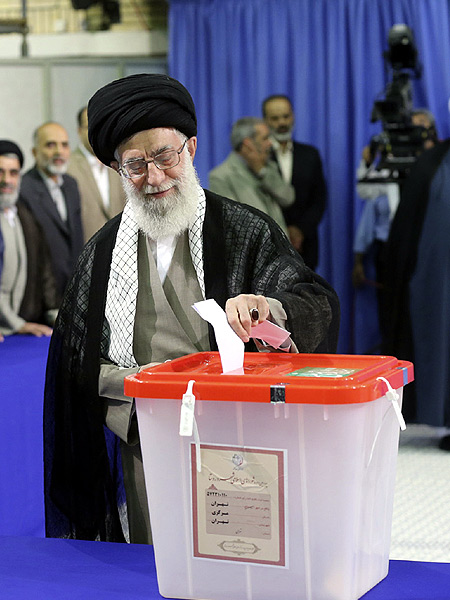 Iran's Supreme Leader Ayatollah Ali Khamenei casts his ballot at his office during the Iranian presidential election in central Tehran