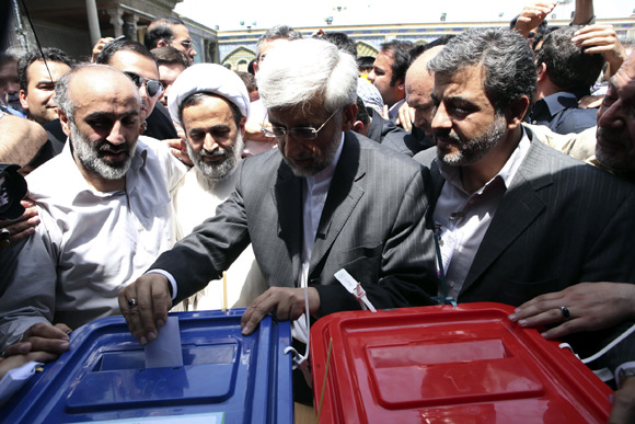 Presidential candidate Saeed Jalili (C) casts his ballot during the Iranian presidential election in Tehran