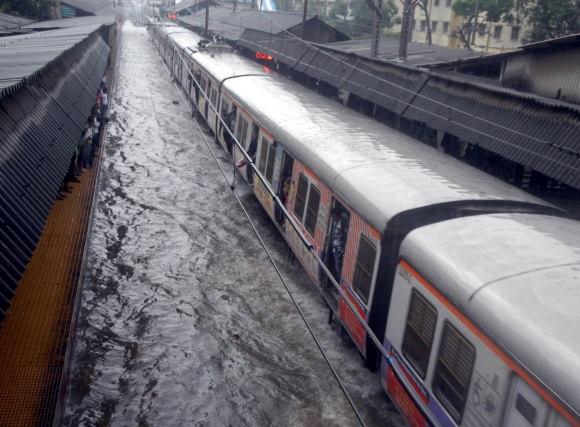 India News - Latest World & Political News - Current News Headlines in India - Photos: Heavy rains hit train services, make Mumbai crawl
