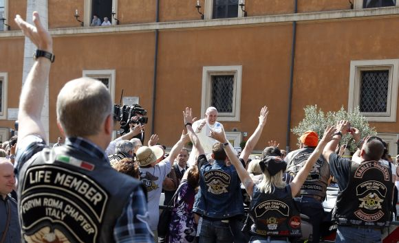 Pope Francis blesses the Harley Davidson bikers from his Popemobile before the start of a mass outside Saint Peter's Square in Rome