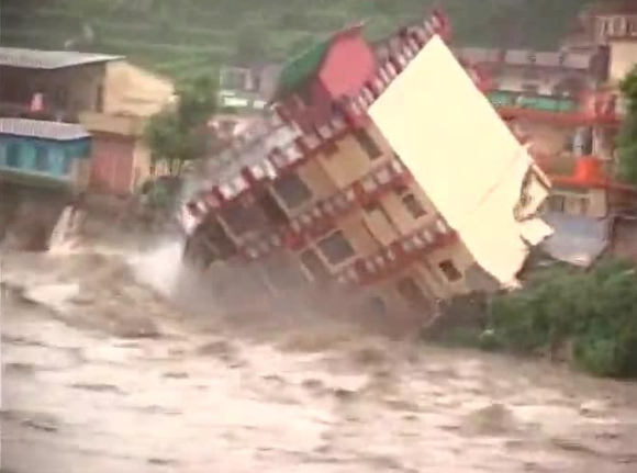 A building collapses due to heavy rains in Uttarakhand