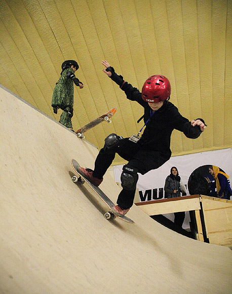 A Skateistan student rides down the ramp at the facility in Kabul