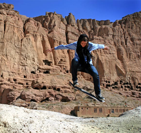Skateistan volunteer Erika ollies in front of the destroyed Buddhas of Bamiyan, which were built in the 6th century but blown up by the Taliban in 2001