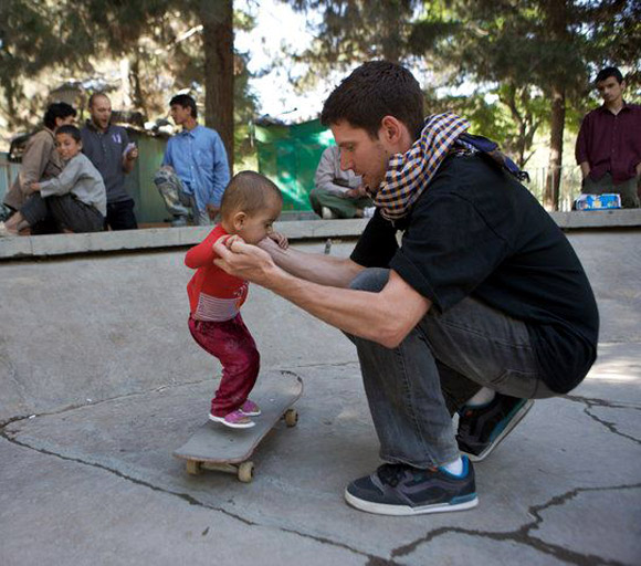 Skateistan's founder and executive director Oliver Percovich with possibly the youngest girl skateboarder in Afghanistan