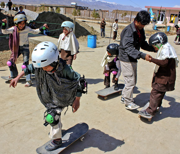 A Skateistan volunteer instructs new entrants on how to use the skateboard in Mazar-e-Sharif. The second facility opened this March after the success of the first project in Kabul and is almost three times the size of Skateistan Kabul